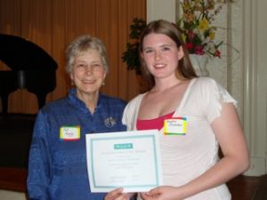 Pictured Pat Higby, chairperson of the Transfer Scholarship committee, presenting Alysha the Transfer Scholarship at the 2011 April annual meeting.