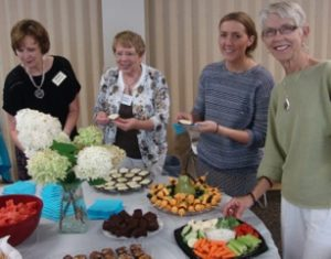 image of members enjoying snacks and conversation