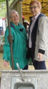 Sandy Lawry on the left and Myrna Sandvik on the right at the Garage and Plant sale, 2019.