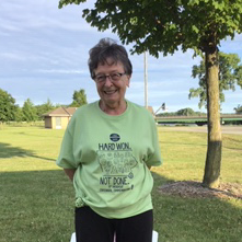 Ardelle Brown at the informal meeting of the executive board on July 20, 2020. Modeling a green Hard Won, Not Done 19th Amendment T-shirt.